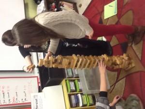 students stacking blocks