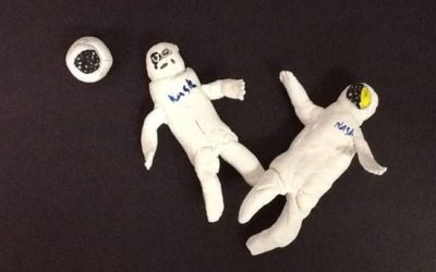 How can I use astronauts to explain collateral damage photograph using clay?